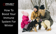 A family with healthy immune systems playing in the snow in winter